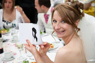 A Happy Bride Holding up a Silhouette of herself