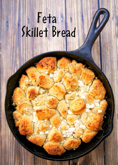 Feta Skillet Bread - only 4 ingredients!  Ready in 15 minutes. Can be a side dish or serve as an appetizer with some warm marinara. It is SO good! We could not stop eating this!
