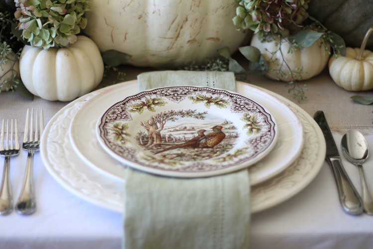 neutral fall tablescape with tranferware plates and white pumpkins