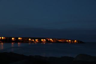 The Cliffs at Keflavik lit up at night