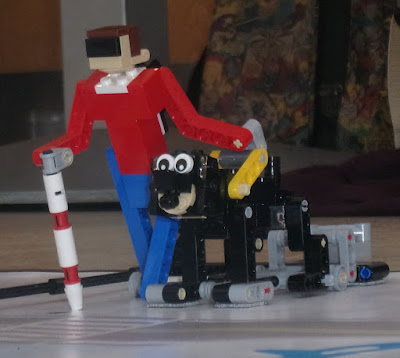 lego blind man and seeing eye dog