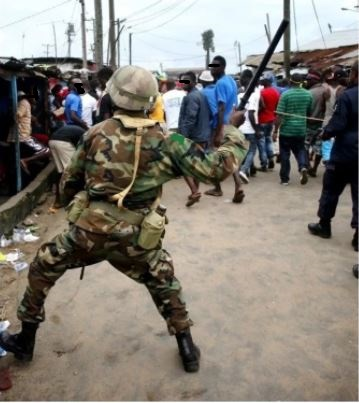 Horror As Soldier Stabs Businessman To Death in Abia,  And beating people