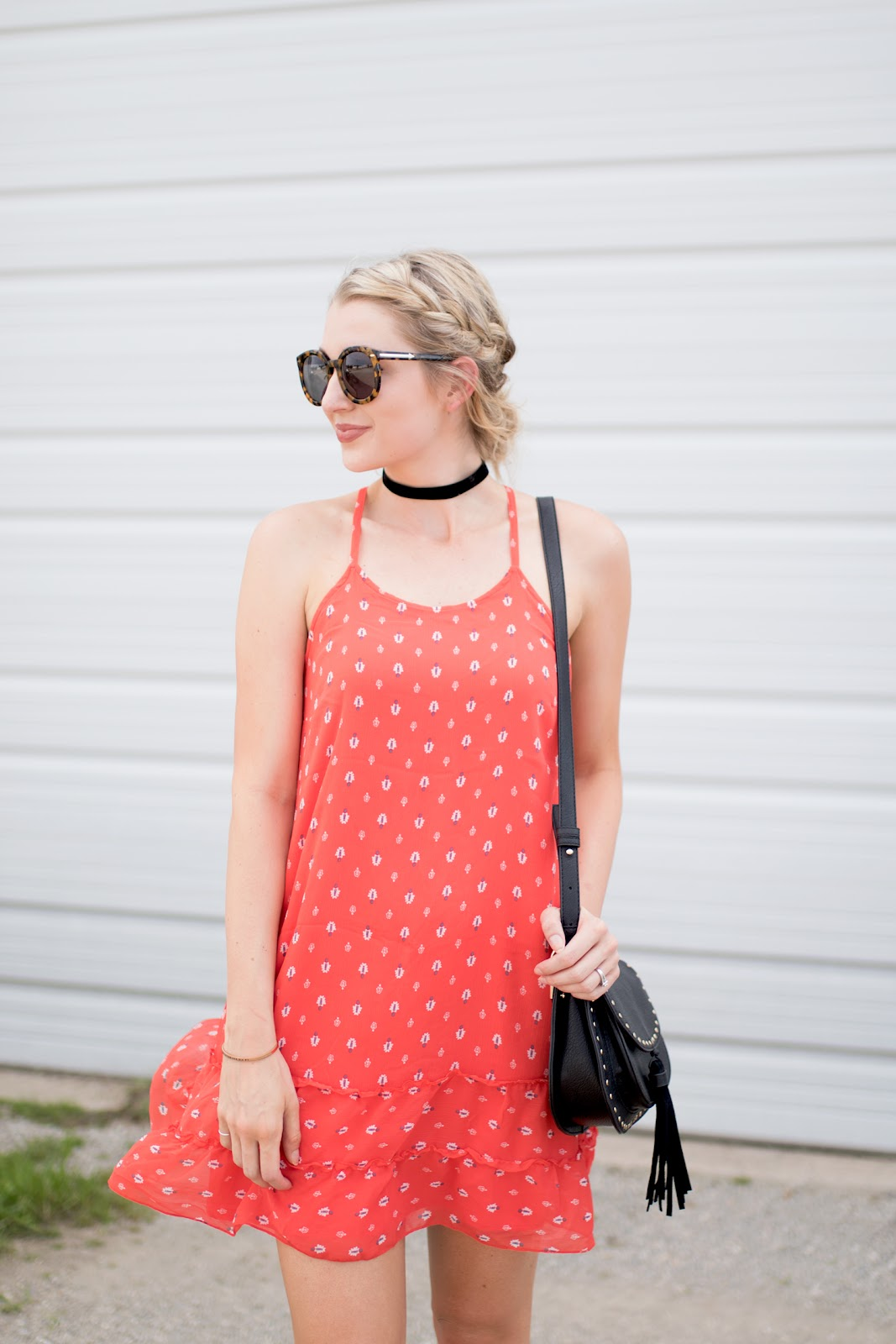Red print dress with black accessories