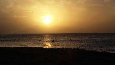 Photo of the sunset in El Cotillo, Fuerteventura, Canary Islands, with surfers