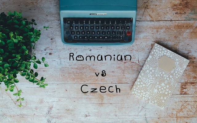 A table with a typewriter, a notebook and a plant as a background for the topic: Romanian versus Czech language words comparison and similar words.