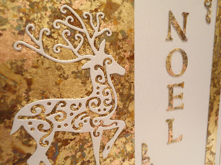 Gold gilded Christmas card with reindeer and Noel close up