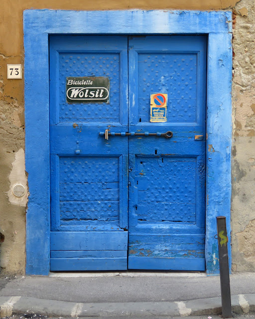 An eye-catching blue door in Via delle Galere, Livorno