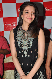 Kajal Aggarwal in lovely Black Sleeveless Anarlaki Dress in Hyderabad at Launch of Bahar Cafe at Madinaguda 038.JPG