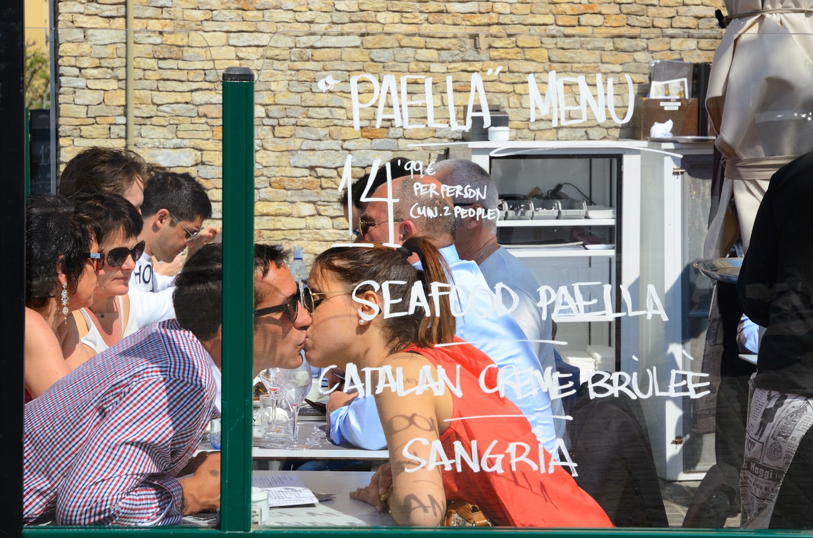 Lovers kissing at Paella restaurant, Barceloneta