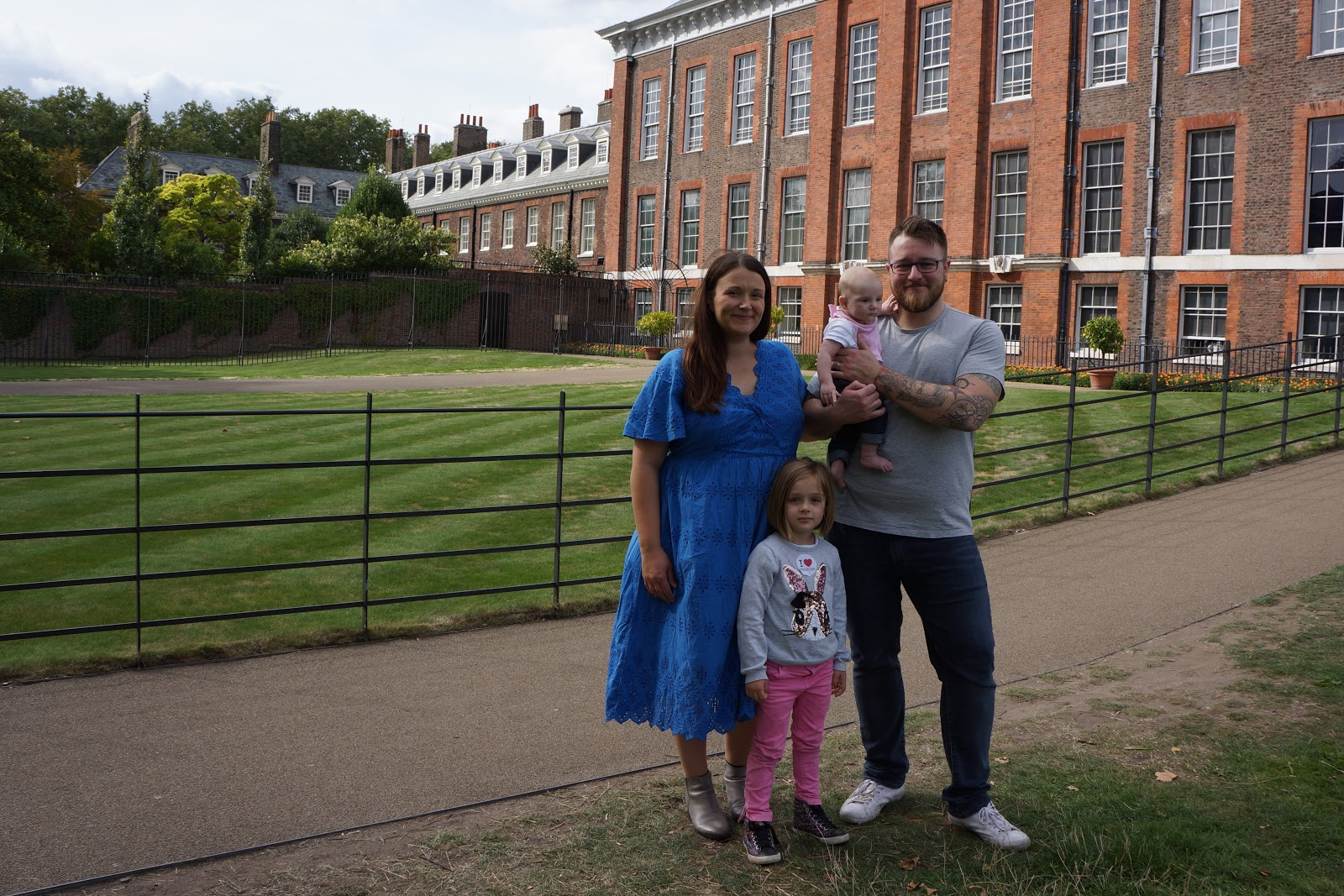family photo in front of kensington palace