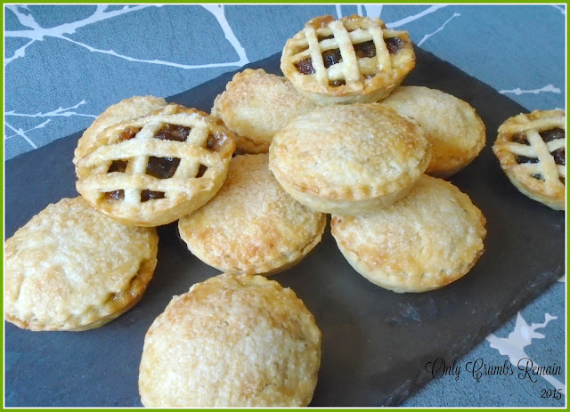 Christmas Mince Pies with Marzipan, some finished with a full lid and others with lattice strips