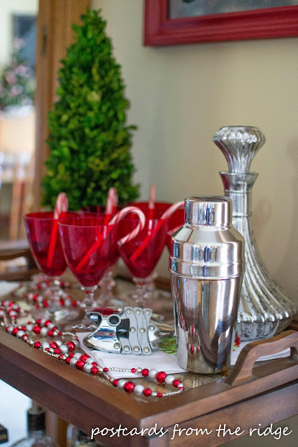 Love this holiday bar cart. Lots of other great Christmas decorating ideas on this site.