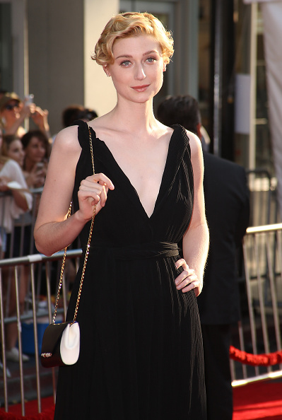 Elizabeth Debicki with leather clutch