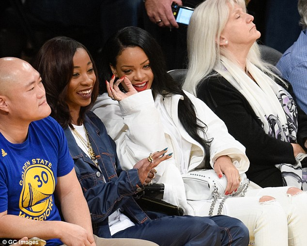 Photos: Rihanna Looks Stunning In All-White Ensemble As She Steps To The Lakers Game