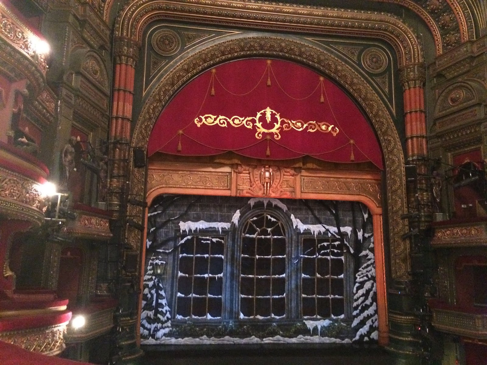 Curtains closed before a performance at The Grand Theatre