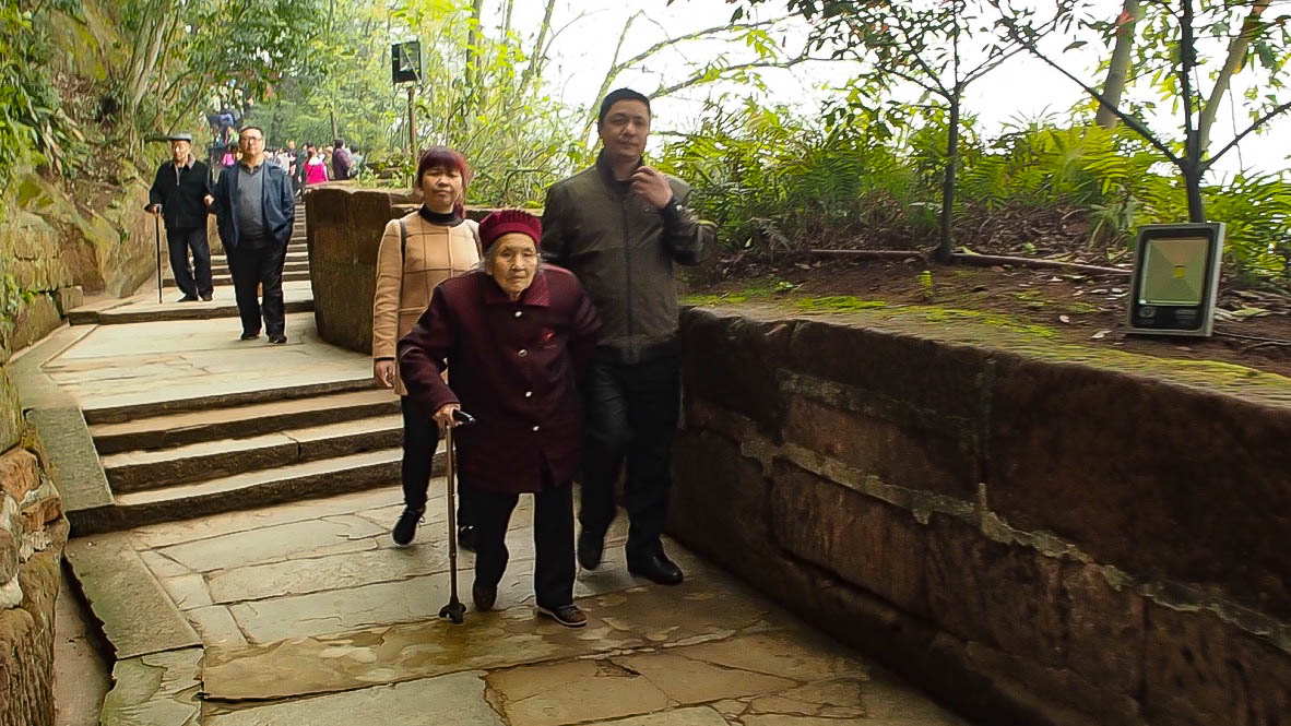 Old Chinese people at Giant Buddha of Leshan, China