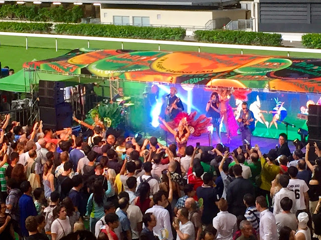 Samba carnival band & dancers at Happy Valley racecourse, Hong Kong
