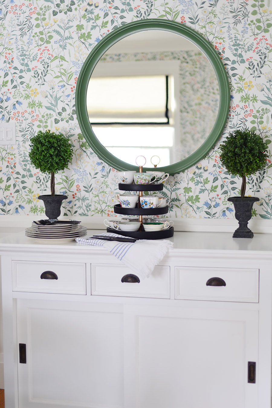 spring decor in dining room, green round mirror, modern floral wallpaper, faux topiary, white buffet cabinet novasolo