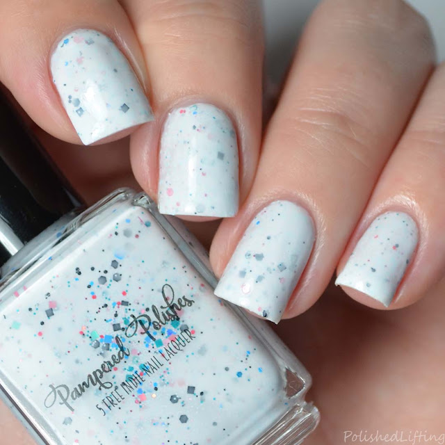 white crelly nail polish with glitter