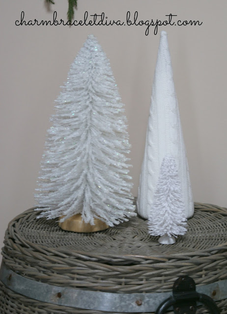 trio of white Christmas trees