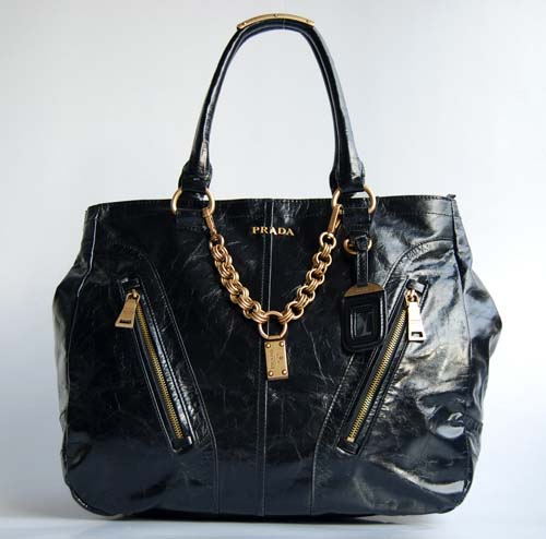 446df3d39558 She unveiled the classic Prada handbag which was simple, sleek, black  nylon, and in 1985 it became an overnight sensation.