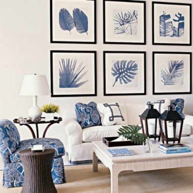 White slipcover sofa, blue and white print slipper chairs in a coastal living room