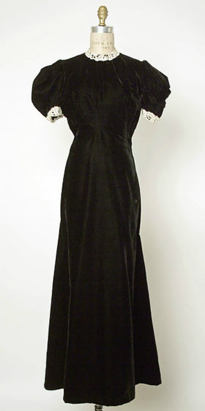 Black evening gown displayed on mannequin. Design by Jacques Fath 1937-1939