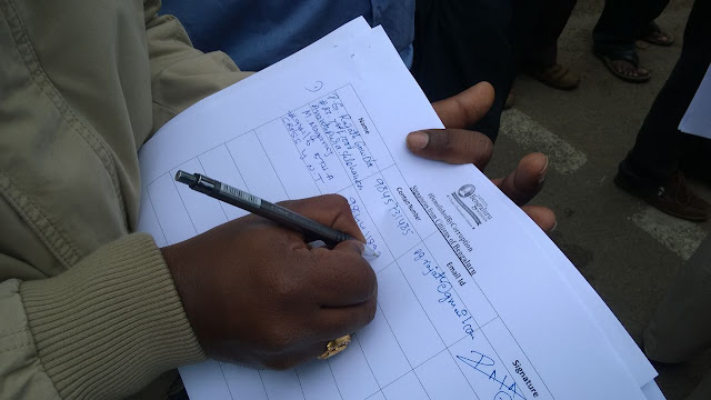 Victims signing the petition to be submitted to CM