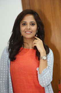 Actress Anasuya Bharadwaj in Orange Short Dress Glam Pics at Winner Movie Press Meet February 2017 (61).JPG