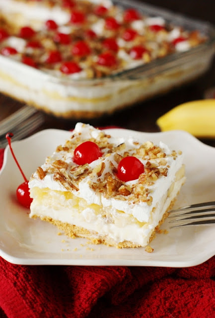 No-Bake Banana Split Cake ~ All the fabulous flavors of a scrumptiously melty banana split sundae, all in an easy to prepare no-bake dessert!   www.thekitchenismyplayground.com