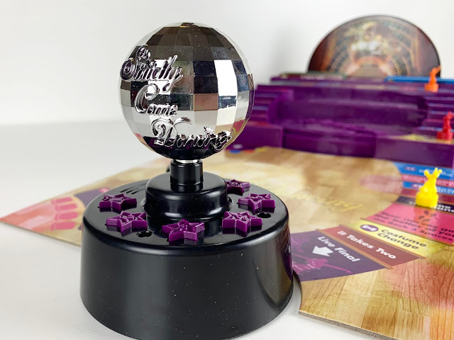 Close up of the Strictly Come Dancing board game glitter ball speaker
