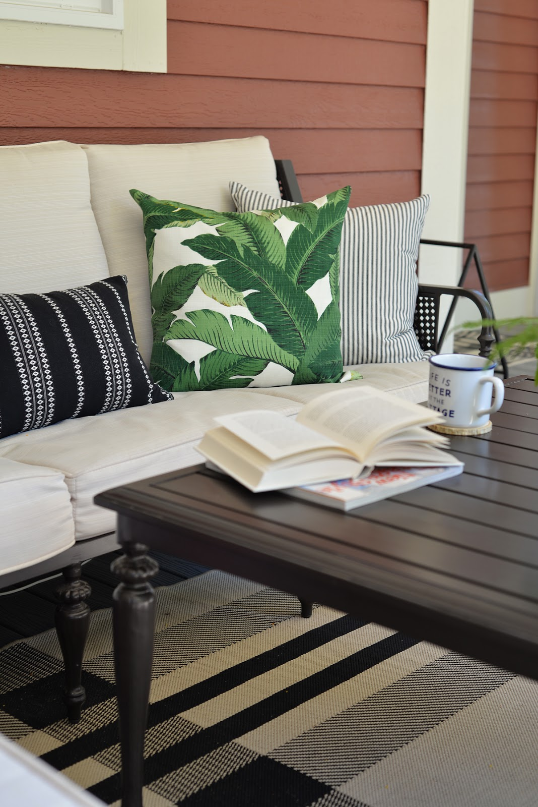 RamblingRenovators.ca | porch decor | British Colonial outdoor furniture, ticking stripe, palm leaves