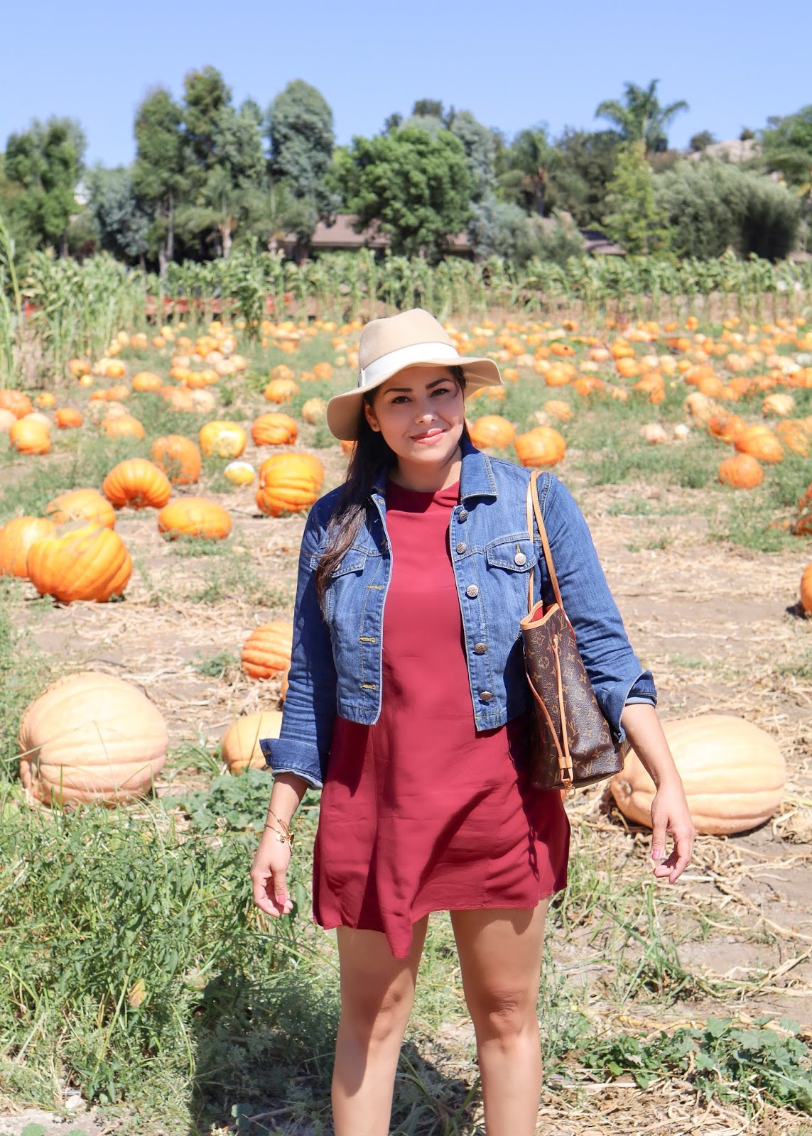 Fall fashion at the pumpkin patch, burgundy dress with jean jacket