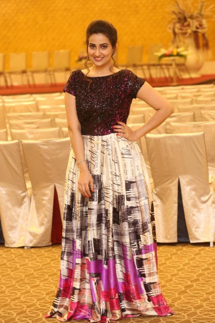 Telugu Tv Anchor Manjusha Stills In Maroon Dress At Movie Success Meet