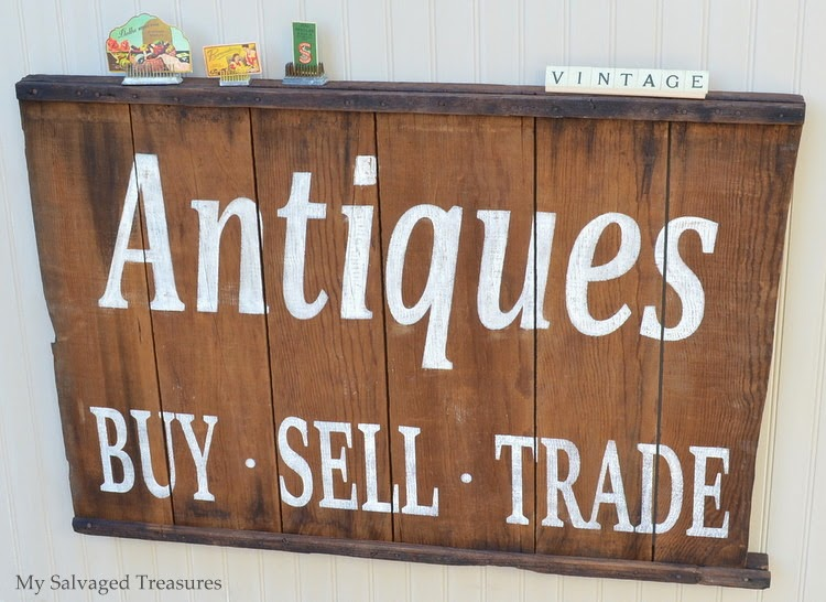 antiques sign made from fruit drying rack