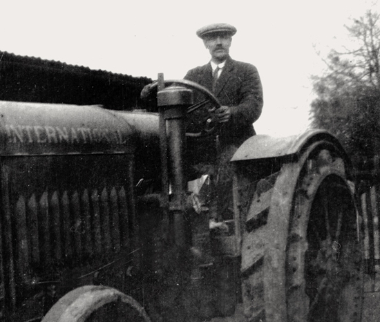 Photograph of James Chuck on a tractor at Potterells in the 1940s. Image from L. Maxwell