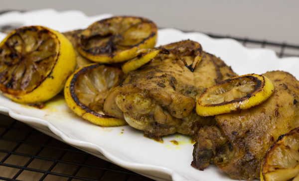 HomeMadeZagat.com - A flavorful entree of chicken marinated in a curry base and baked to perfection