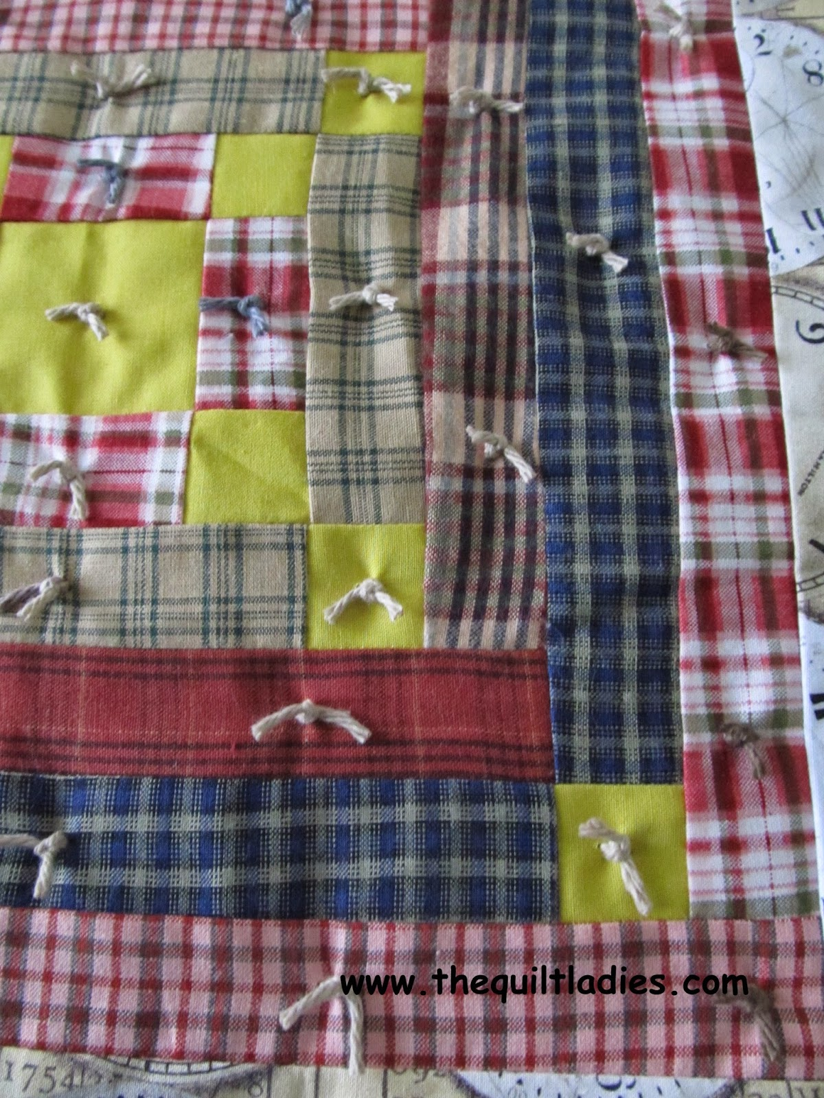 how to tie a quilt with yarn and a needle.