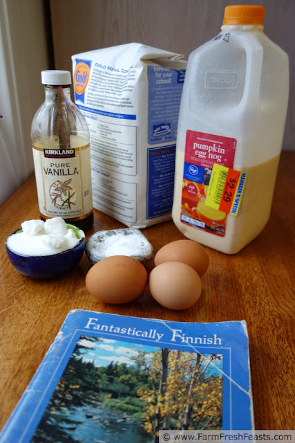 image of ingredients needed to make Finnish Oven Pancake with eggnog, plus the recipe book which inspired this recipe