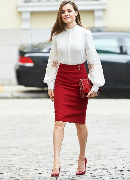 Queen Letizia wore Hugo Boss Vasela-Slim fit pencil skirt, and Hugo Boss Staple red pumps carried Carolina Herrera Animal Print Clutch