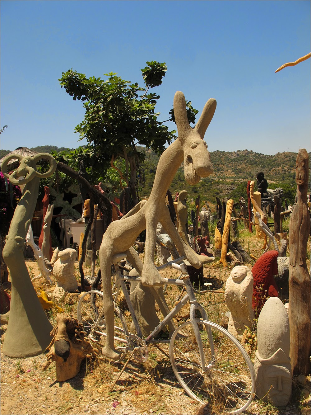 In An Outburst Of Creativity A Multitude Of Sculptures Arose On The Site,  Mostly Lifesize, Often Totemlike, Made From Treetrunks, Wood Or Concrete,