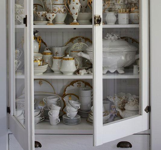 Beautiful white farmhouse cupboard - found on Hello Lovely Studio