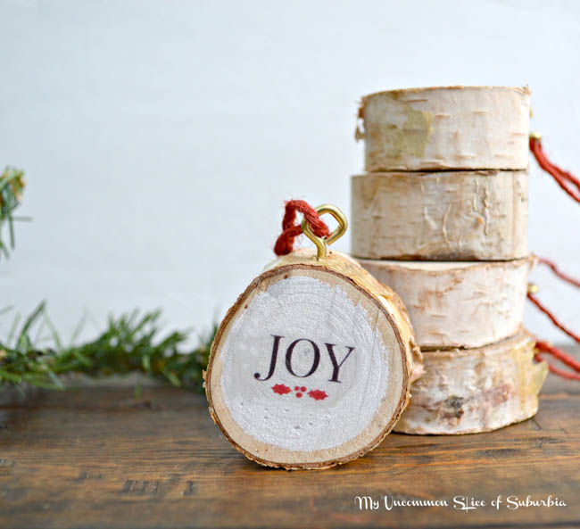 birch wood cutting decorated for Christmas with joy word