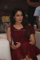 Pragya Jaiswal in Stunnign Deep neck Designer Maroon Dress at Nakshatram music launch ~ CelebesNext Celebrities Galleries 125.JPG