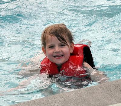having fun in the indoor water park pool