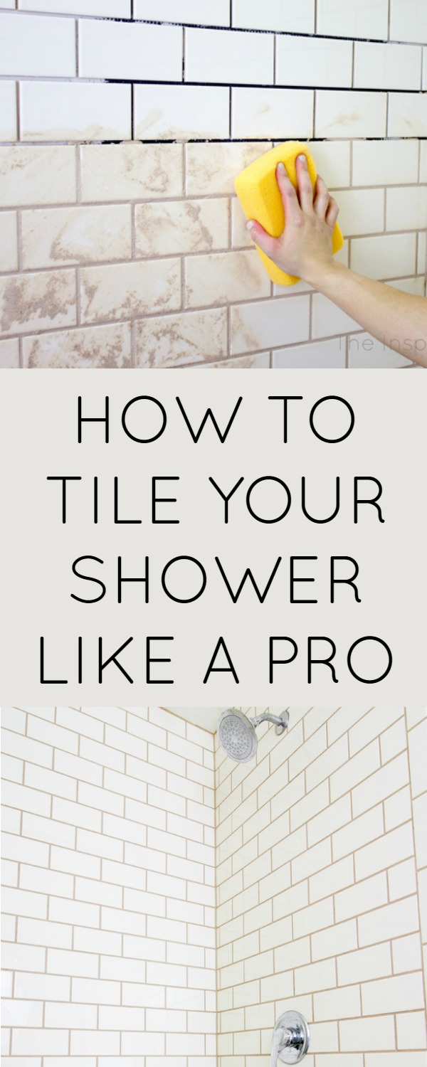 How to tile shower. Hand holding sponge applying grout to cream subway tile in shower.
