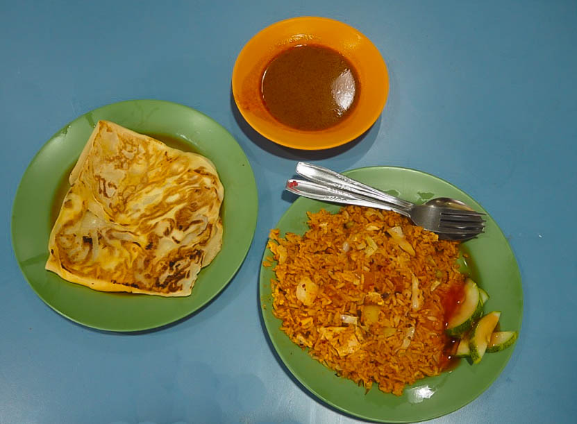 Nasi goreng, curry sauce and egg roti