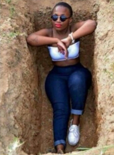 Ghanaian lady taking photo in a grave