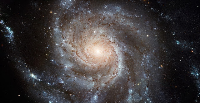 "This Hubble image reveals the gigantic Pinwheel galaxy, one of the best known examples of ""grand design spirals"", and its supergiant star-forming regions in unprecedented detail. The image is the largest and most detailed photo of a spiral galaxy ever released from Hubble. Credit: ESA/NASA"