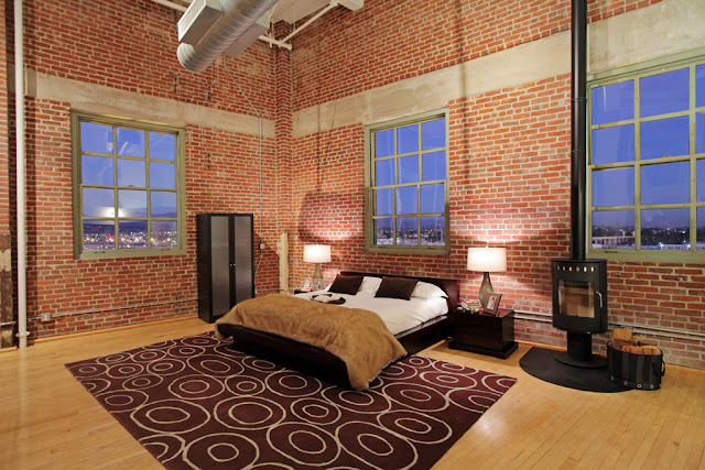 Photo of modern bedroom in the penthouse loft